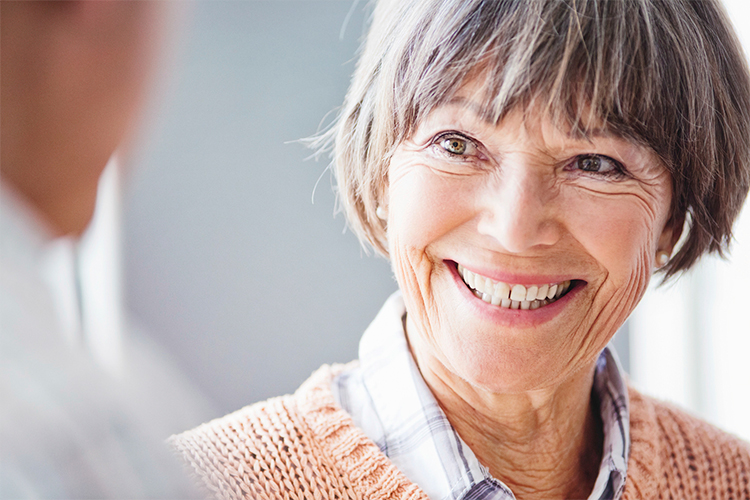 Older woman getting great news from her audiologist