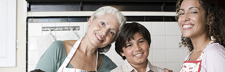 grandmother, daughter, and grandson baking in the kitchen together