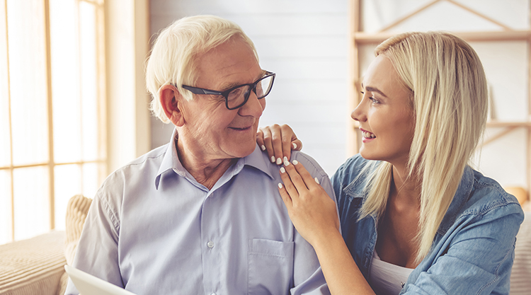Older man talking to a family member about hearing loss